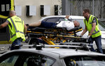 FILE - In this March 15, 2019, file photo, ambulance staff take a man from outside a mosque in central Christchurch, New Zealand. Tentative plans for a movie that recounts the response of New Zealand Prime Minister Jacinda Ardern to a gunman's slaughter of Muslim worshippers drew criticism in New Zealand on Friday, June 11, 2021 for not focusing on the victims of the attacks. (AP Photo/Mark Baker, File)