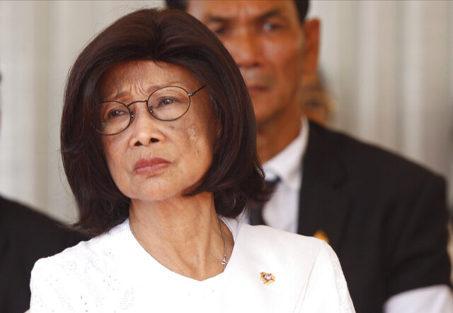 In this June 20, 2018, photo, Princess Norodom Buppha Devi, eldest daughter of the country's late King Norodom Sihanouk, attends the cremation ceremony of her sister in-law, Ouk Phalla, in Phnom Penh, Cambodia. Princess Norodom Buppha Devi, has died at age 76. (AP Photo/Heng Sinith)