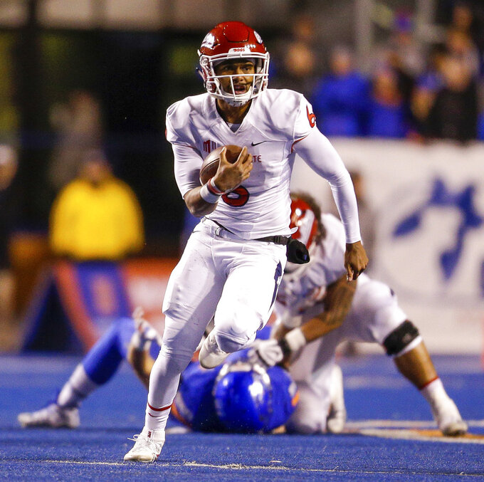 Fresno State quarterback Marcus McMaryion (6) scrambles with the ball during the first half of the team's NCAA college football game against Boise State on Friday, Nov. 9, 2018, in Boise, Idaho. (AP Photo/Steve Conner)