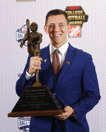 FILE - In this Dec. 6, 2018, file photo, Texas A&M's Braden Mann poses with the trophy after winning The Ray Guy Award for being the top punter in college football, in Atlanta. Mann was named to the 2018 AP All-America NCAA college football team, Monday, Dec. 10, 2018. (AP Photo/John Bazemore, File)