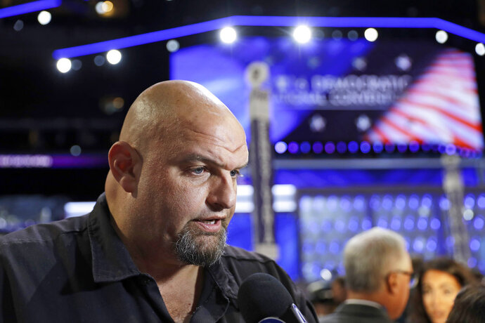 FILE – In this July 27, 2016, file photo, John Fetterman, mayor of Braddock, Pa., talks to a reporter on the third day of the Democratic National Convention in Philadelphia. Democrats in Pennsylvania nominated Fetterman to replace incumbent Democratic Lt. Gov. Mike Stack during the state's Tuesday, May 15, 2018, primary election, and Gov. Tom Wolf met Fetterman for lunch the next day to get to know the governor's new running mate better. (AP Photo/Matt Rourke, File)