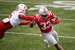 Nebraska defensive back Cam Taylor-Britt, left, forces Ohio State running back Master Teague out of bounds during the first half of an NCAA college football game Saturday, Oct. 24, 2020, in Columbus, Ohio. (AP Photo/Jay LaPrete)