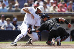 San Diego Padres' Eric Hosmer, left, is tagged out at home by Boston Red Sox catcher Christian Vazquez during the third inning of a baseball game Sunday, Aug. 25, 2019, in San Diego. (AP Photo/Gregory Bull)
