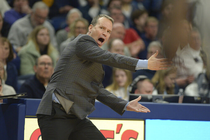 Northwestern coach Chris Collins barks instructions to his players during an NCAA college basketball game against Penn State, Saturday, Feb. 15, 2020, in State College, Pa. (AP Photo/Gary M. Baranec)