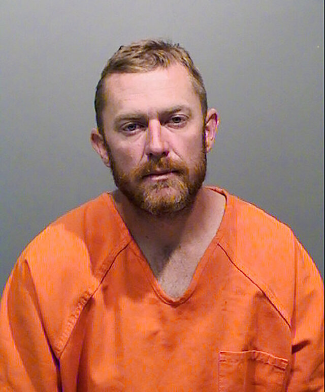 This undated booking photo from the Jefferson County Sheriff's Office shows Eric Breemen, 36. Breemen who is accused of running over the Sikh owner of a suburban Denver liquor store after reportedly telling him and his wife to