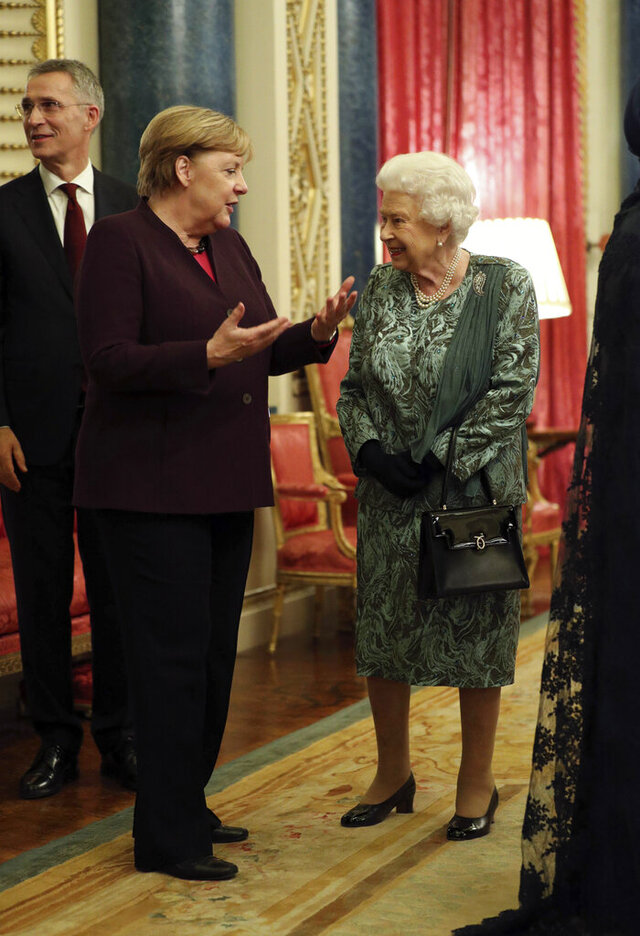 Britain's Queen Elizabeth talks to Chancellor of Germany Angela Merkel during a reception at Buckingham Palace, as NATO leaders gather to mark 70 years of the alliance, in London, Tuesday, Dec. 3, 2019. U.S. President Donald Trump and his NATO counterparts were gathering in London Tuesday to mark the alliance's 70th birthday amid deep tensions as spats between leaders expose a lack of unity that risks undermining military organization's credibility. (Yui Mok/Pool Photo via AP)