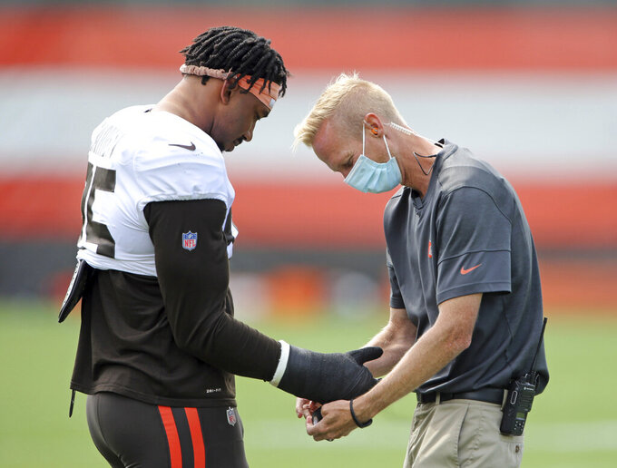 Cleveland Browns defensive end Myles Garrett gets his wrist wrapped before practice Tuesday, Sept. 1, 2020, in Berea, Ohio. (Joshua Gunter/Cleveland.com via AP)