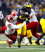 Michigan running back Karan Higdon (22) runs as Indiana defensive back Khalil Bryant (29) makes the tackle in the first half of an NCAA college football game in Ann Arbor, Mich., Saturday, Nov. 17, 2018. (AP Photo/Paul Sancya)