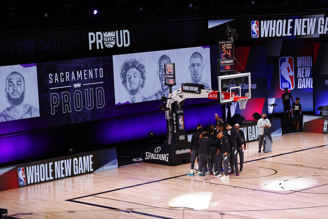 The Sacramento Kings take the court against the New Orleans Pelicans prior to the start of the game of an NBA basketball game Tuesday, Aug. 11, 2020, in Lake Buena Vista, Fla. (Mike Ehrmann/Pool Photo via AP)