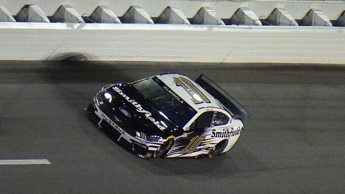 Driver Aric Almirola (10) runs during a NASCAR Daytona 500 qualifying session Wednesday, Feb. 10, 2021, at Daytona International Speedway in Daytona Beach, Fla. Almirola qualified third for Sunday's race. (AP Photo/Chris O'Meara)