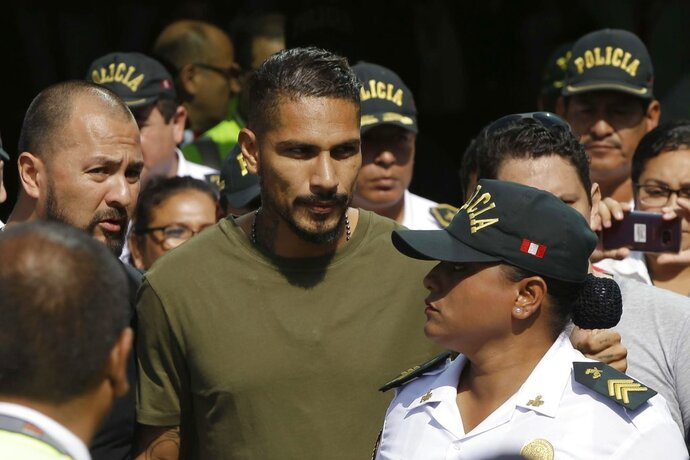 Peru captain Paolo Guerrero arrives in Lima, Peru, Tuesday, May 15, 2018. The global footballers' union wants FIFA's help to review anti-doping rules after Guerrero was banned from the World Cup for a positive test for cocaine caused by contaminated tea. FIFPro says a 14-month ban barring the 34-year-old Guerrero from his World Cup debut is