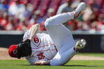 Cincinnati Reds starting pitcher Sonny Gray rolls on the field after missing a bunt single hit by Philadelphia Phillies' Bryce Harper in the first inning of a baseball game, Thursday, Sept. 5, 2019, in Cincinnati. (AP Photo/John Minchillo)