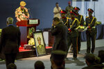 Ethiopia's Prime Minister Abiy Ahmed, center, attends a state ceremony for assassinated army chief Gen. Seare Mekonnen, at the Millennium Hall in the capital Addis Ababa, Ethiopia Tuesday, June 25, 2019. Ethiopia's Prime Minister Abiy Ahmed sobbed openly at the service Tuesday for the military chief who was assassinated by his own bodyguard over the weekend. (AP Photo/Mulugeta Ayene)