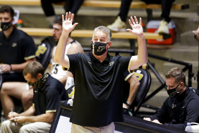 Purdue head coach Matt Painter motions to his team during the first half of an NCAA college basketball game against Oakland Tuesday, Dec. 1, 2020 in West Lafayette, Ind. (Nikos Frazier/Journal & Courier via AP)