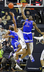 Vanderbilt guard Joe Toye, center, shoots between Tennessee State's Donte Fitzpatrick-Dorsey (3) and Emmanuel Egbuta (2) in the first half of an NCAA college basketball game Saturday, Dec. 29, 2018, in Nashville, Tenn. Vanderbilt won 95-76. (AP Photo/Mark Humphrey)