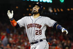 Houston Astros' Robinson Chirinos celebrates his two-run home run during the fourth inning of Game 4 of the baseball World Series against the Washington Nationals Saturday, Oct. 26, 2019, in Washington. (AP Photo/Jeff Roberson)