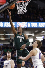 Michigan State forward Aaron Henry, center, shoots between Northwestern guard Pat Spencer, left, and forward Miller Kopp during the first half of an NCAA college basketball game Wednesday, Dec. 18, 2019, in Evanston, Ill. (AP Photo/Nam Y. Huh)
