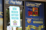 FILE - In this Thursday, May 18, 2017 file photo, Parking signs greet visitors at the New Mexico Lottery headquarters in Albuquerque, N.M., . A growing number of states are moving to allow winners of big lottery jackpots to stay anonymous. While New Mexico's governor opted for transparency and recently pocket vetoed legislation, Arizona could join the list under a proposal headed to Republican Gov. Doug Ducey. (AP Photo/Susan Montoya Bryan, File)