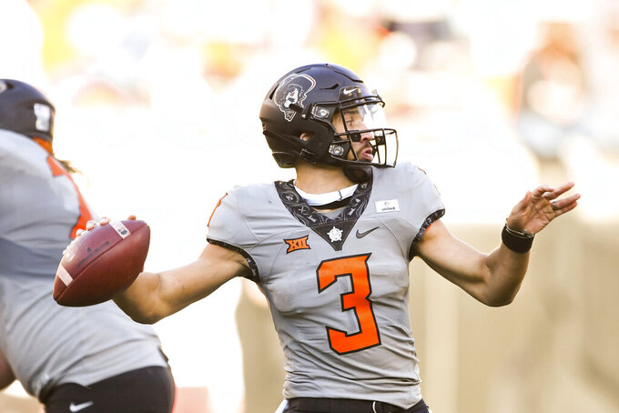 Oklahoma State quarterback Spencer Sanders (3) throws a pass during an NCAA college football game Saturday, Oct. 24, 2020, in Stillwater, Okla. (AP Photo/Brody Schmidt)