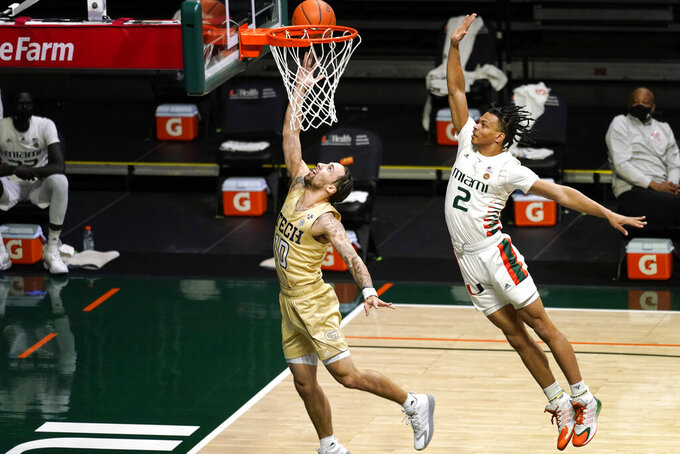Georgia Tech guard Jose Alvarado, left, shoots ahead of Miami guard Isaiah Wong (2) during the first half of an NCAA college basketball game, Saturday, Feb. 20, 2021, in Coral Gables, Fla. (AP Photo/Lynne Sladky)