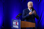 Democratic presidential candidate former Vice President Joe Biden removes his face mask as he arrives to speaks in Wilmington, Del., Wednesday, Sept. 2, 2020, about school reopenings. (AP Photo/Carolyn Kaster)