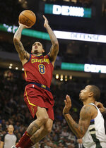 Cleveland Cavaliers' Jordan Clarkson (8) shoots against Milwaukee Bucks' George Hill during the second half of an NBA basketball game Monday, Oct. 28, 2019, in Milwaukee. (AP Photo/Jeffrey Phelps)