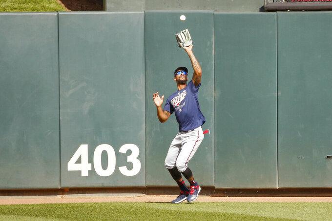Minnesota Twins' Byron Buxton fields a ball in an intrasquad baseball game Monday, July 13, 2020, in Minneapolis. (AP Photo/Bruce Kluckhohn)