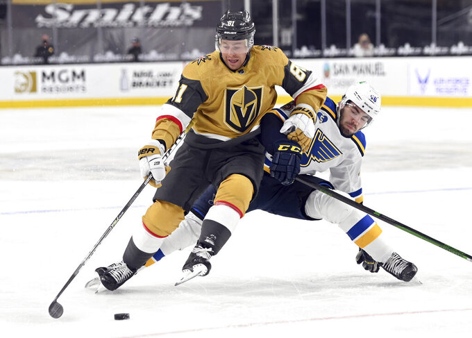 Vegas Golden Knights center Jonathan Marchessault (81) fends off St. Louis Blues defenseman Jake Walman (46) during the second period of an NHL hockey game Saturday, May 8, 2021, in Las Vegas. (AP Photo/David Becker)