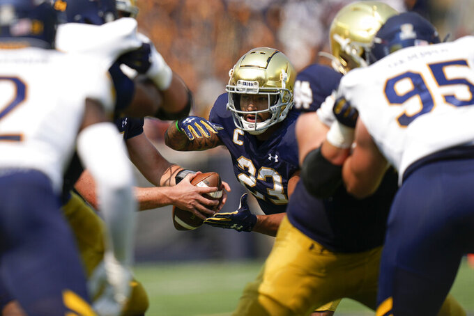 Notre Dame running back Kyren Williams (23) takes a handoff while playing Toledo in the first half of an NCAA college football game in South Bend, Ind., Saturday, Sept. 11, 2021. (AP Photo/AJ Mast)