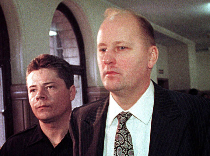 FILE - In a Thursday, April 15, 1999 file photo, Tim Boczkowski is led away from a courtroom in Pittsburgh, Pa.,  who was convicted of killing two of his wives in two states could be released from a North Carolina prison, potentially cutting short his life sentence after more than 22 years. North Carolina's parole commission said Wednesday, Nov. 7, 2018, it was collecting information ahead of a decision on whether to release Tim Boczkowski. (AP Photo/Gary Tramontina)