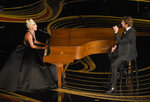 FILE - This Feb. 24, 2019 file photo shows Lady Gaga, left, and Bradley Cooper performing