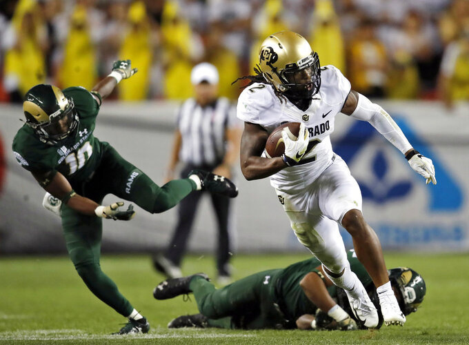 "FILE - In this Aug. 31, 2018, file photo, Colorado wide receiver Laviska Shenault Jr. (2) runs upfield with a reception in the second half of an NCAA college football game against Colorado State in Denver. Shenault is a shy, soft-spoken person. That is, until he steps onto the field and transforms into an alter ego he's nicknamed ""Viska 2Live,"" becoming an electric playmaker who's vaulted into the conversation for the Heisman Trophy. (AP Photo/David Zalubowski, File)"