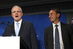 Australian Prime Minister Scott Morrison, left, speaks next to Liberal candidate Dave Sharma at a Liberal Party Wentworth by-election function in Double Bay in Sydney, Saturday, Oct. 20, 2018. With 15 percent of votes counted Saturday, Sharma conceded defeat to independent candidate Kerryn Phelps.Australia's ruling coalition will be forced into minority government after a heavy defeat in a by-election for former Liberal Party Prime Minister Malcolm Turnbull's old seat. (Chris Pavlich/AAP Image via AP)