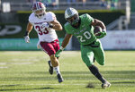 Marshall running back Brenden Knox (20) pulls away from UMass line backer Mike Ruane (33) on his way to a 45-yard touchdown during an NCAA football game on Saturday, Nov. 7, 2020, at Joan C. Edwards Stadium in Huntington, W.Va. (Sholten Singer/The Herald-Dispatch via AP)