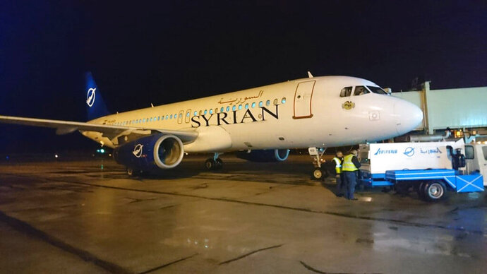 In this photo released by the Syrian official news agency SANA, a Syrian commercial plane coming from Lebanon, lands at Aleppo Airport, Syria, early Friday, Jan. 15, 2021. Syrian Air conducted its first flight in a decade between the northern city of Aleppo and Lebanon's capital Beirut on Friday, resuming a round-trip route that's been halted since Syria's conflict began in 2011. (SANA via AP)