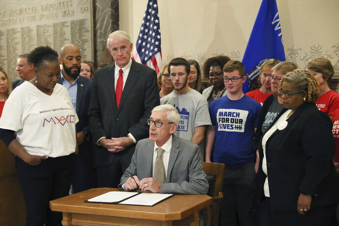 Gov. Tony Evers speaks at a news conference at Milwaukee City Hall signing an executive order calling a special session on gun laws, Monday, Oct. 21, 2019. (Michael Sears/Milwaukee Journal-Sentinel via AP)
