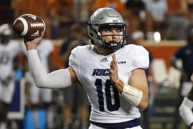 Rice quarterback Jake Constantine (10) looks to pass against Texas during the second half of an NCAA college football game on Saturday, Sept. 18, 2021, in Austin, Texas. (AP Photo/Chuck Burton)