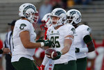 Colorado State tight end Trey McBride (85) is congratulated by teammates after scoring a touchdown during the first half of the team's NCAA college football game against New Mexico on Friday, Oct. 11, 2019, in Albuquerque, N.M. (AP Photo/Andres Leighton)