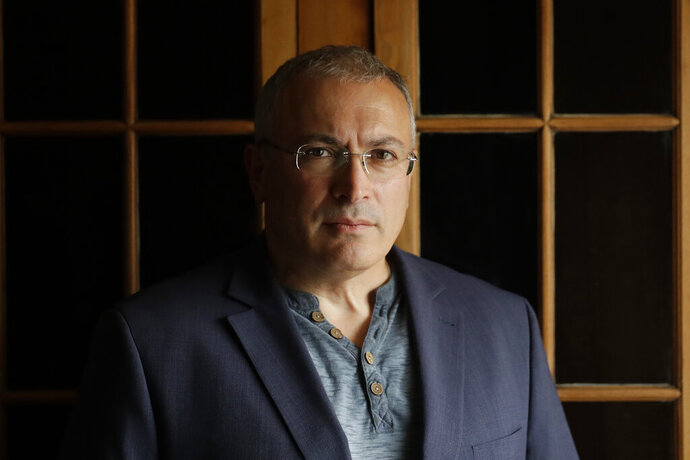 FILE - In this Tuesday, July 24, 2018 file photo, Russian opposition figure Mikhail Khodorkovsky, the former owner of the Yukos Oil Company, poses for a photograph after being interviewed by The Associated Press in London. A Dutch appeals court on Tuesday Feb. 18, 2020, reinstated an international arbitration panel's order to Russia to pay $50 billion compensation to shareholders in former Russian oil giant Yukos. (AP Photo/Matt Dunham, File)