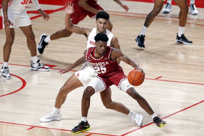 Temple guard Jeremiah Williams (25) is pressured by Houston guard Quentin Grimes, back, during the first half of an NCAA college basketball game Tuesday, Dec. 22, 2020, in Houston. (AP Photo/Michael Wyke)