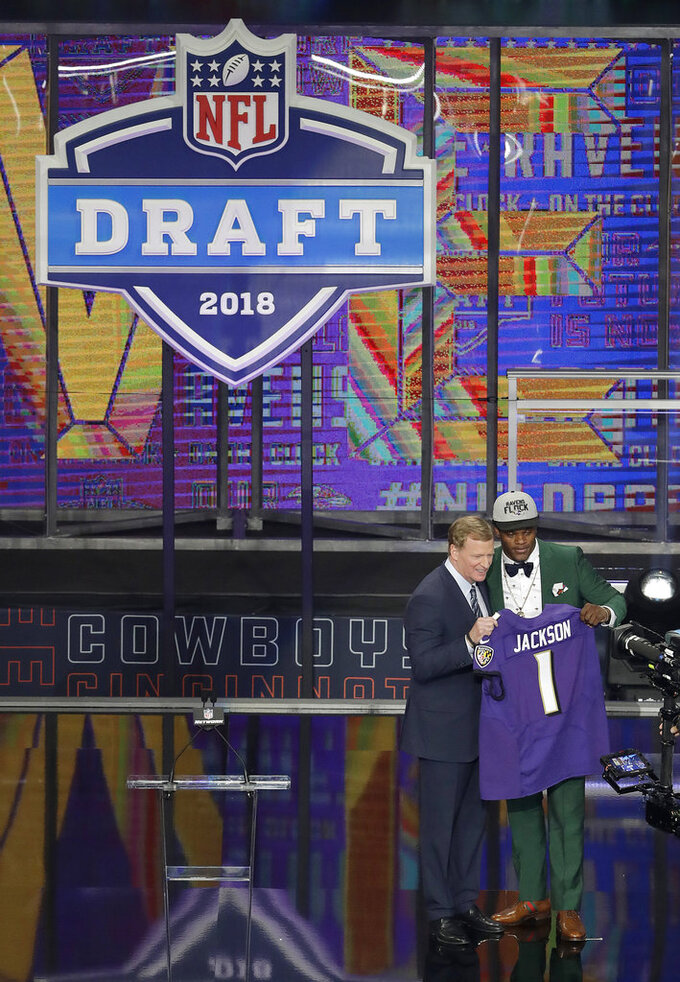 FILE - In this April 26, 2018, file photo, Commissioner Roger Goodell presents Louisville's Lamar Jackson with his Baltimore Ravens team jersey during the first round of the NFL football draft, in Arlington, Texas. The NFL is partnering with Caesars Entertainment as its first official casino sponsor, but the deal does not include sports betting or fantasy football. The multiyear arrangement announced Thursday, Jan. 3, 2019, begins with this weekend's playoffs. Caesars will have exclusive rights to NFL trademarks in the U.S. and United Kingdom, including the Super Bowl and draft. Caesars will host parts of the 2020 draft. (AP Photo/Eric Gay, File)