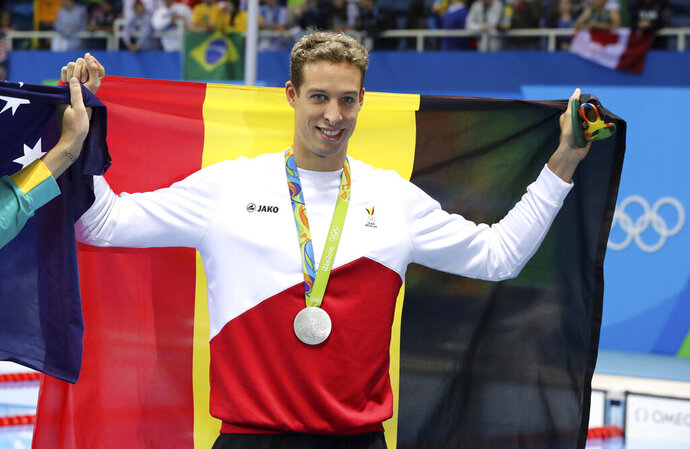 FILE - In this Thursday, Aug. 11, 2016 file photo, Belgium's Pieter Timmers holds up his silver medal after the men's 100-meter freestyle during the swimming competitions at the 2016 Summer Olympics, in Rio de Janeiro, Brazil. Belgian swimmer Pieter Timmers had planned to retire after Tokyo last summer. He's decided to stick to his timeline rather than disrupt his family's plans. (AP Photo/Lee Jin-man, file)