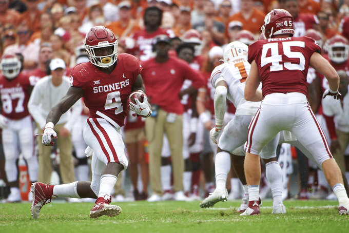 Oklahoma running back Trey Sermon (4) breaks free against Texas during the second half of an NCAA college football game at the Cotton Bowl, Saturday, Oct. 6, 2018, in Dallas. (AP Photo/Cooper Neill)