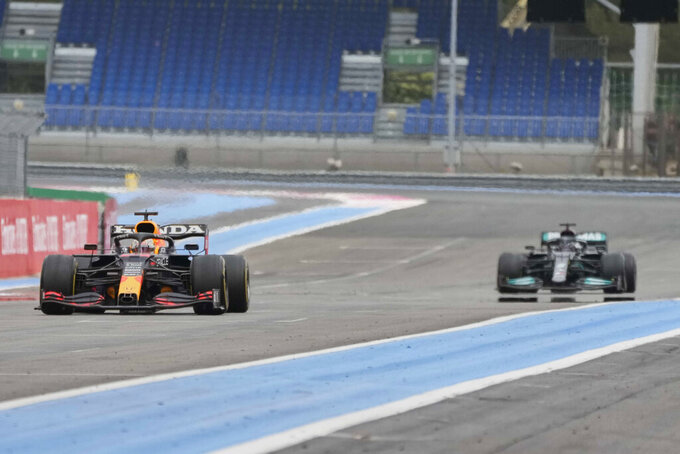 Red Bull driver Max Verstappen of the Netherlands before crossing the finish line to win the French Formula One during the Grand Prix at the Paul Ricard racetrack in Le Castellet, southern France, Sunday, June 20, 2021. (AP Photo/Francois Mori)