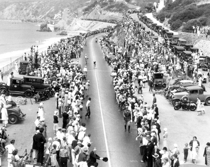 FILE - In this Aug. 4, 1932, file photo, Italian cyclist Attilio Pavesias pedals down the home stretch, lined by a cheering throng, to win the Olympic 10-kilometer road race near Los Angeles. The course was over the California State Highway from Moorpark to Castellemar, a distance of 62.14 miles. Pavesi's time for the distance was 2 hours, 28 minutes, 5 3/5 seconds. (AP Photo/File)