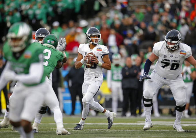 Utah State quarterback Jordan Love (10) looks to throw a pass against North Texas during the second half of the New Mexico Bowl NCAA college football game in Albuquerque, N.M., Saturday, Dec. 15, 2018. Utah State won 52-13. (AP Photo/Andres Leighton)