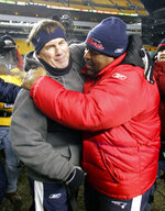 FILE - In this Jan. 23, 2005, file photo, New England Patriots coach Bill Belichick, left, hugs defensive coordinator Romeo Crennel after they defeated the Pittsburgh Steelers 41-27 to win the AFC Championship game in Pittsburgh. While Belichick owns a record six Super Bowl championship rings, his former New England assistants have combined for one playoff victory as head coaches. (AP Photo/Winslow Townson, File)