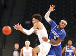 Georgia Tech guard Jordan Usher and Georgia State guard Corey Allen (11) battle for the ball during the first half of an NCAA college basketball game, Wednesday, Nov. 25, 2020 in Atlanta. (Curtis Compton/Atlanta Journal-Constitution via AP)