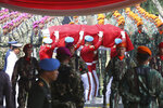 Indonesian soldiers carry the coffin containing former Indonesian President Bacharuddin Jusuf Habibie during funeral services at Hero's cemetery Kalibata in Jakarta, Indonesia, Thursday, Sept. 12, 2019. Habibie, who allowed democratic reforms and an independence referendum for East Timor following the ouster of the dictator Suharto, has been buried at a state funeral. (AP Photo/Achmad Ibrahim)