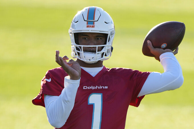 Dolphins quarterback Tua Tagovailoa throws the ball during a practice and media availability by the Miami Dolphins In Ware, England, Friday, Oct. 15, 2021. The Dolphins play the Jaguars in a regular season NFL game on Sunday at Tottenham Hotspurs White Hart Lane stadium in London. (AP Photo/Alastair Grant)